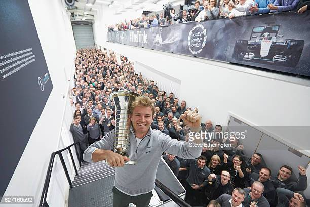 Nico Rosberg of Germany and Mercedes GP celebrates winning the F1 World Drivers Championship with Mercedes GP staff on December 1 2016 in Brackley...