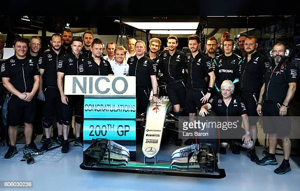 Nico Rosberg of Germany and Mercedes GP celebrates with his team at the start of practice for his 200th F1 Grand Prix during practice for the Formula...