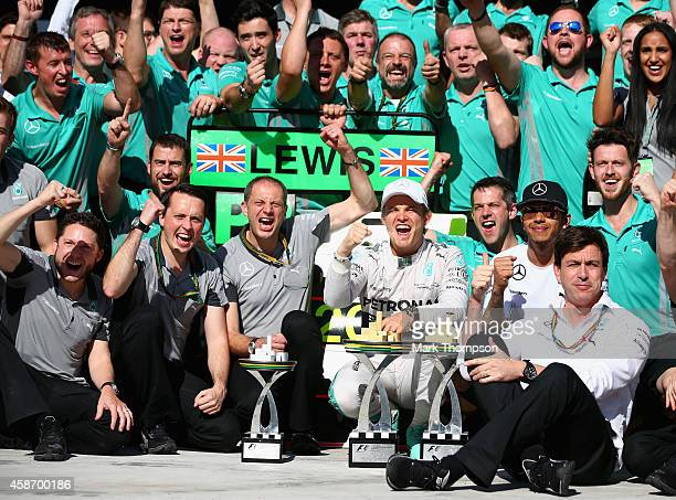 Nico Rosberg of Germany and Mercedes GP celebrates with his team including Lewis Hamilton of Great Britain and Mercedes GP Executive Director Toto...