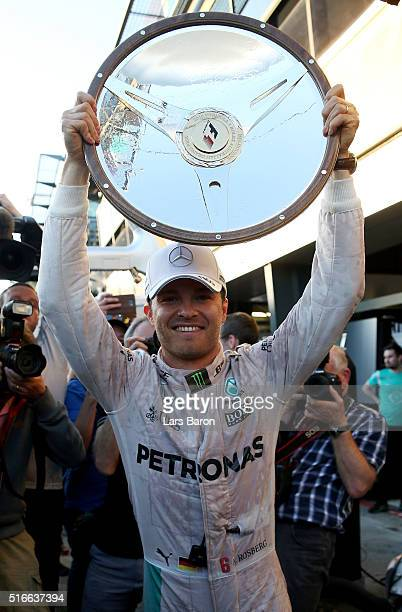 Nico Rosberg of Germany and Mercedes GP celebrates with his trophy during the Australian Formula One Grand Prix at Albert Park on March 20 2016 in...