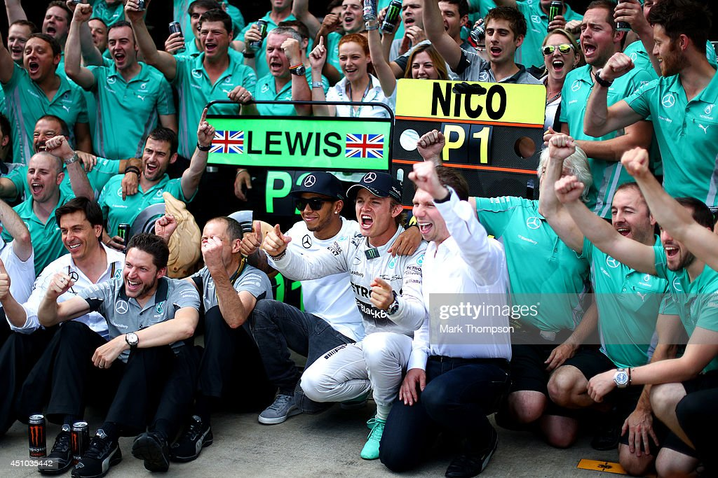 Nico Rosberg of Germany and Mercedes GP celebrates with Lewis Hamilton of Great Britain and Mercedes GP after victory in the Austrian Formula One Grand Prix at Red Bull Ring on June 22, 2014 in Spielberg, Austria.