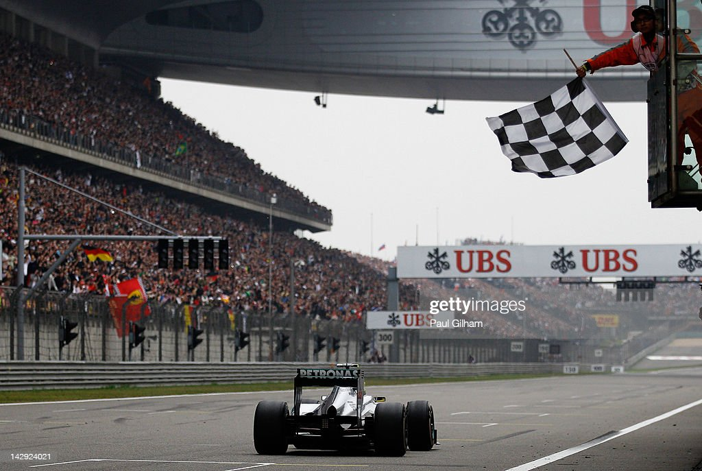 Nico Rosberg of Germany and Mercedes GP crosses the finishing line to win the Chinese Formula One Grand Prix at the Shanghai International Circuit on April 15, 2012 in Shanghai, China.