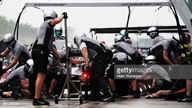 Nico Rosberg of Germany and Mercedes GP drives in for a pitstop during qualifying for the Malaysia Formula One Grand Prix at the Sepang Circuit on...