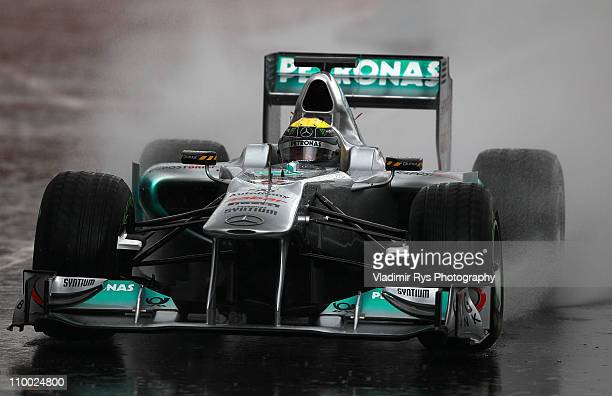 Nico Rosberg of Germany and Mercedes GP drives into the pits during the Formula One testing at Circuit de Catalunya on March 12, 2011 in Barcelona,...