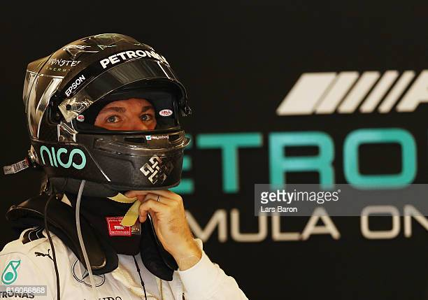 Nico Rosberg of Germany and Mercedes GP gets ready in the garage during practice for the United States Formula One Grand Prix at Circuit of The...