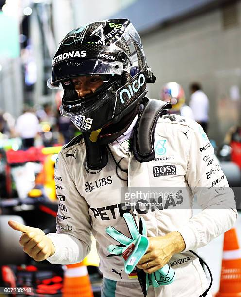 Nico Rosberg of Germany and Mercedes GP gives a thumbs up in parc ferme after qualifying on pole position during qualifying for the Formula One Grand...