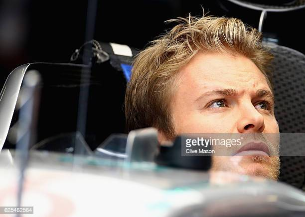 Nico Rosberg of Germany and Mercedes GP has a seat fitting in the garage during previews for the Abu Dhabi Formula One Grand Prix at Yas Marina...