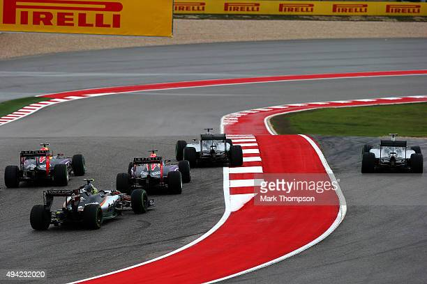 Nico Rosberg of Germany and Mercedes GP is forced wide by Lewis Hamilton of Great Britain and Mercedes GP ahead of Daniel Ricciardo of Australia and...