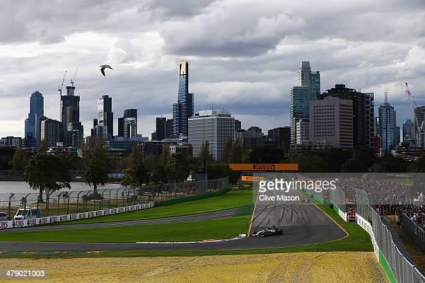 Nico Rosberg of Germany and Mercedes GP leads from Daniel Ricciardo of Australia and Infiniti Red Bull Racing during the Australian Formula One Grand...