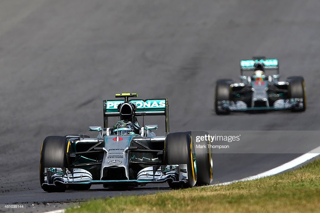 Nico Rosberg of Germany and Mercedes GP leads Lewis Hamilton of Great Britain and Mercedes GP during the Austrian Formula One Grand Prix at Red Bull Ring on June 22, 2014 in Spielberg, Austria.