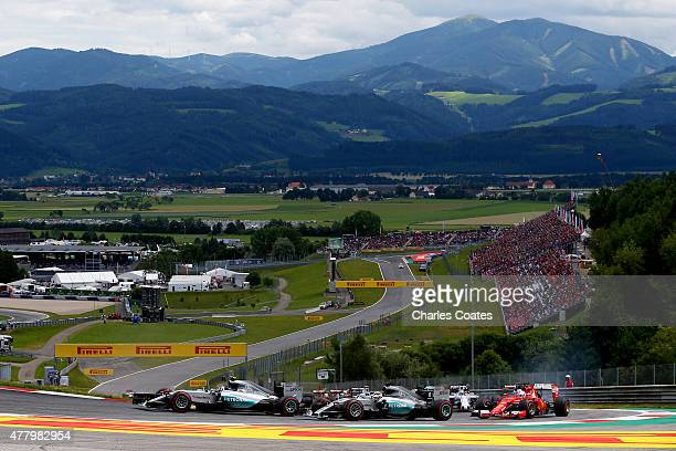 Nico Rosberg of Germany and Mercedes GP leads Lewis Hamilton of Great Britain and Mercedes GP and Sebastian Vettel of Germany and Ferrari into the...