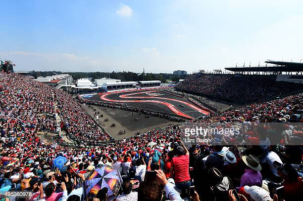 Nico Rosberg of Germany and Mercedes GP leads Lewis Hamilton of Great Britain and Mercedes GP Daniil Kvyat of Russia and Infiniti Red Bull Racing and...