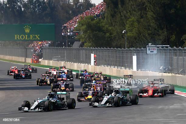 Nico Rosberg of Germany and Mercedes GP leads Lewis Hamilton of Great Britain and Mercedes GP Daniil Kvyat of Russia and Infiniti Red Bull Racing...