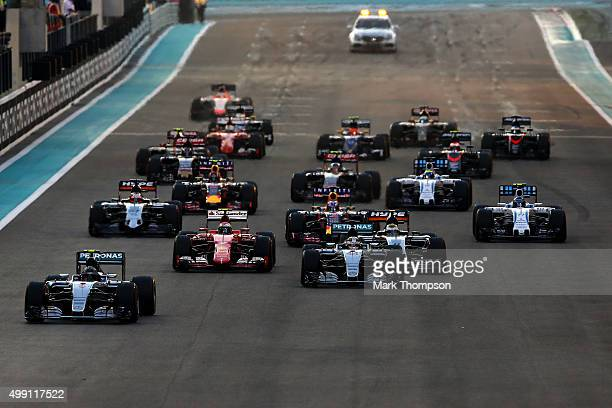 Nico Rosberg of Germany and Mercedes GP leads Lewis Hamilton of Great Britain and Mercedes GP into the first corner during the Abu Dhabi Formula One...