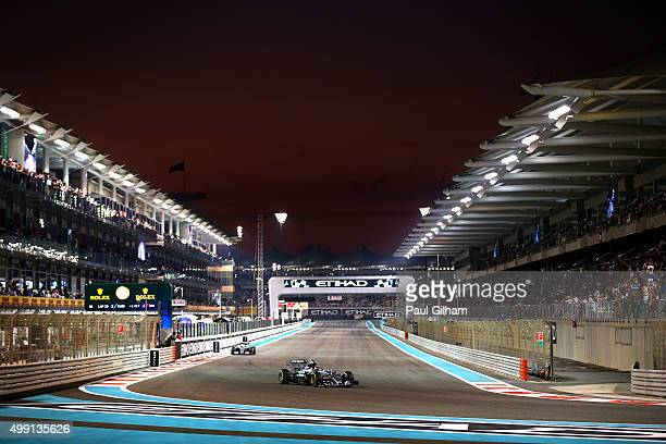 Nico Rosberg of Germany and Mercedes GP leads Lewis Hamilton of Great Britain and Mercedes GP during the Abu Dhabi Formula One Grand Prix at Yas...