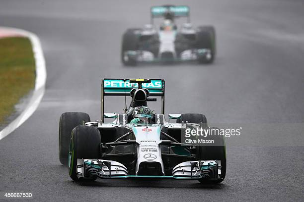 Nico Rosberg of Germany and Mercedes GP leads teammate Lewis Hamilton of Great Britain and Mercedes GP during the Japanese Formula One Grand Prix at...