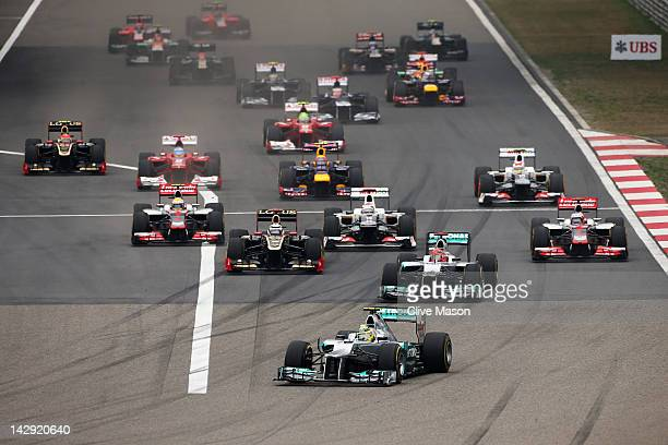 Nico Rosberg of Germany and Mercedes GP leads the field at the start of the Chinese Formula One Grand Prix at the Shanghai International Circuit on...