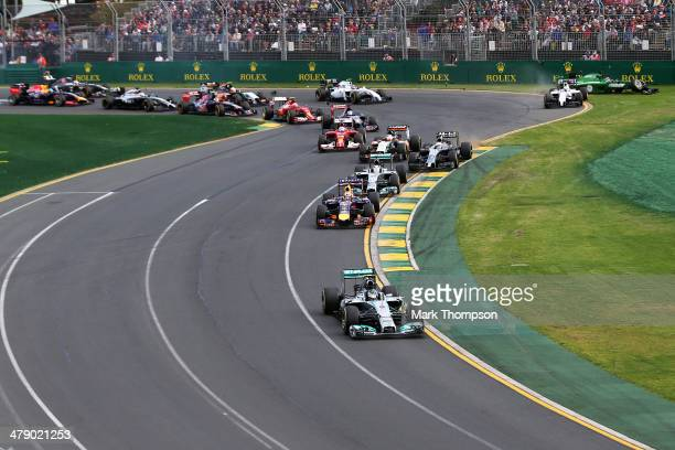 Nico Rosberg of Germany and Mercedes GP leads the field into the first corner as in the background Felipe Massa of Brazil and Williams and Kamui...