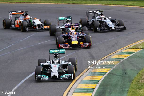 Nico Rosberg of Germany and Mercedes GP leads the field into the first corner at the start of the Australian Formula One Grand Prix at Albert Park on...