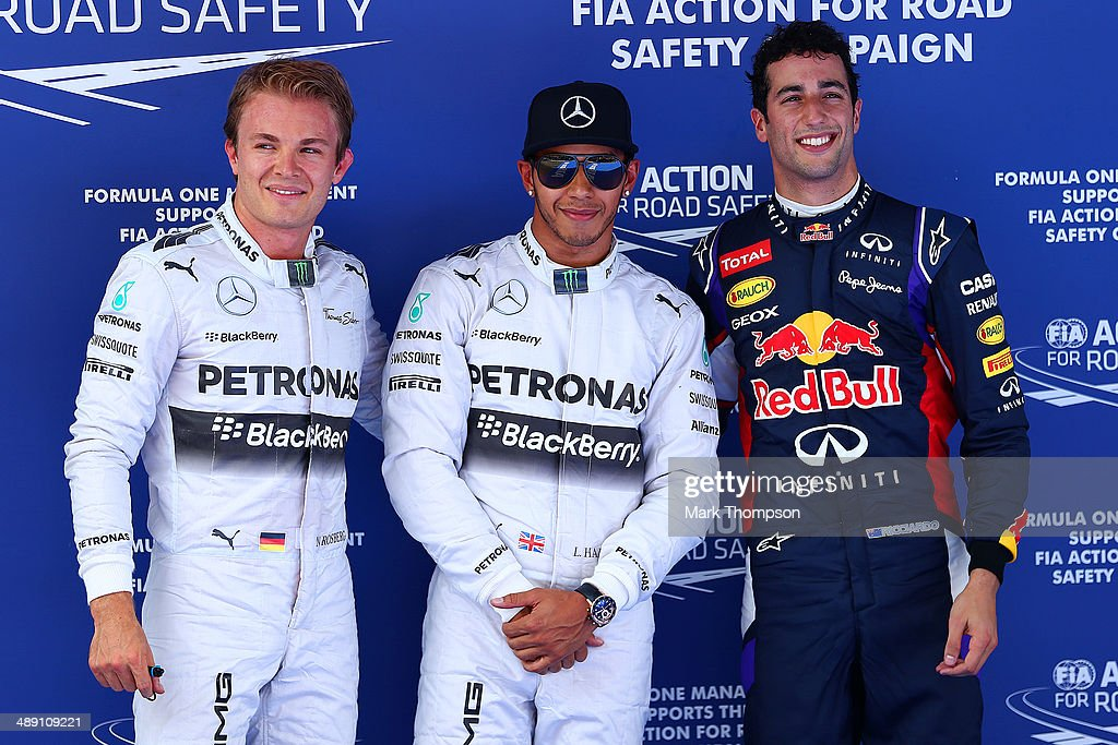 Nico Rosberg (#2 on grid) of Germany and Mercedes GP, Lewis Hamilton (Pole Position) of Great Britain and Mercedes GP and Daniel Ricciardo (#3 on grid) of Australia and Infiniti Red Bull Racing acknowledge the fans during qualifying ahead of the Spanish F1 Grand Prix at Circuit de Catalunya on May 10, 2014 in Montmelo, Spain.