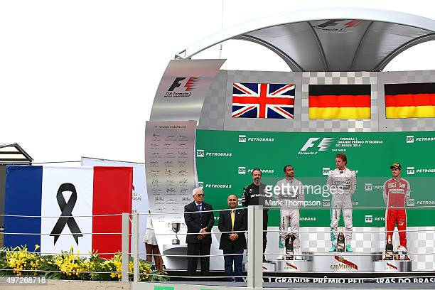 Nico Rosberg of Germany and Mercedes GP Lewis Hamilton of Great Britain and Mercedes GP and Sebastian Vettel of Germany and Ferrari stand on the...