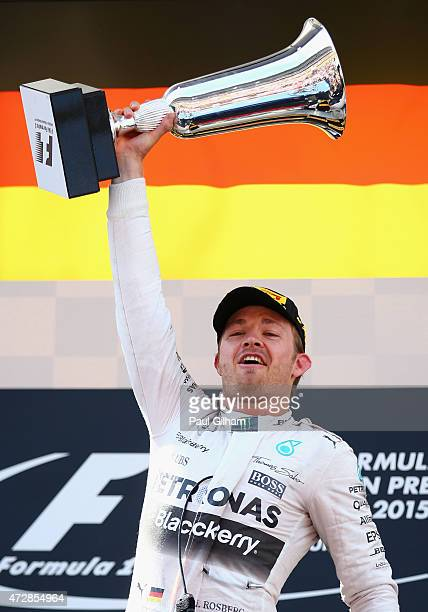 Nico Rosberg of Germany and Mercedes GP lifts the trophy as he celebrates on the podium after winning the Spanish Formula One Grand Prix at Circuit...