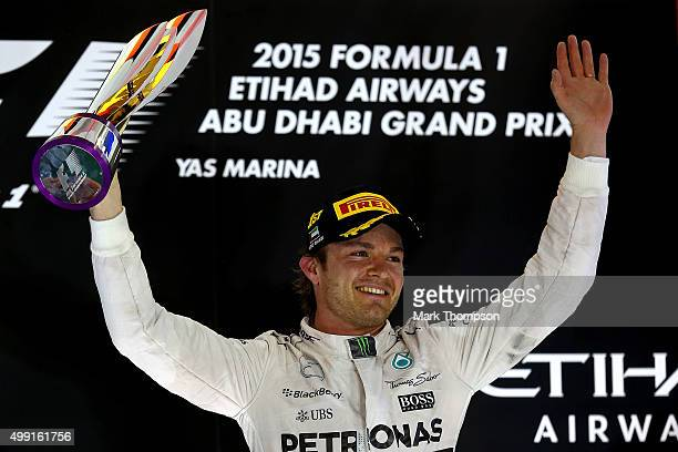 Nico Rosberg of Germany and Mercedes GP lifts the trophy on the podium after winning the Abu Dhabi Formula One Grand Prix at Yas Marina Circuit on...