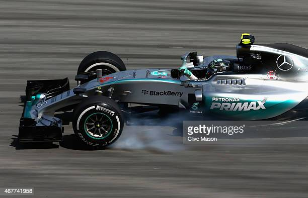 Nico Rosberg of Germany and Mercedes GP locks up during practice for the Malaysia Formula One Grand Prix at Sepang Circuit on March 27 2015 in Kuala...