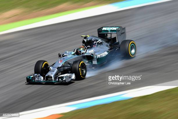 Nico Rosberg of Germany and Mercedes GP locks up during qualifying ahead of the German Grand Prix at Hockenheimring on July 19 2014 in Hockenheim...
