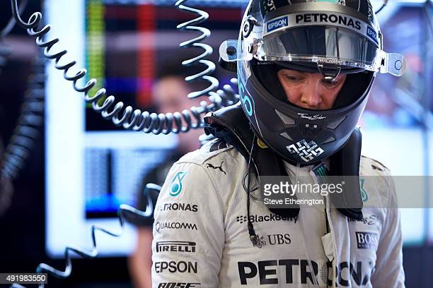 Nico Rosberg of Germany and Mercedes GP looks on in the garage during practice for the Formula One Grand Prix of Russia at Sochi Autodrom on October...