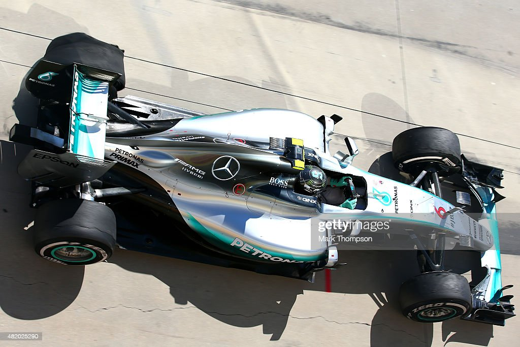 Nico Rosberg of Germany and Mercedes GP makes a pit stop due to a tyre puncture towards the end of the Formula One Grand Prix of Hungary at Hungaroring on July 26, 2015 in Budapest, Hungary.
