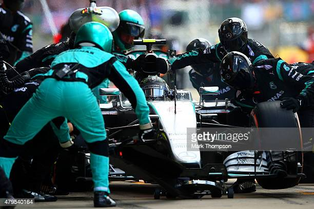 Nico Rosberg of Germany and Mercedes GP makes a pit stop during the Formula One Grand Prix of Great Britain at Silverstone Circuit on July 5 2015 in...