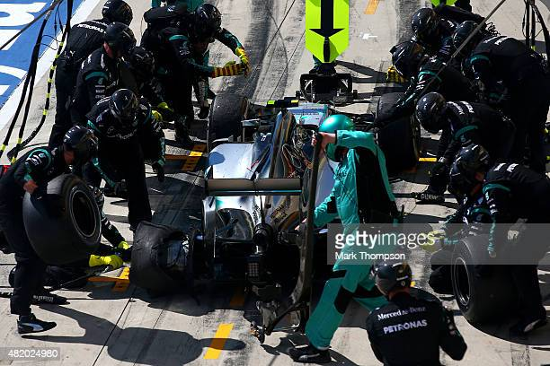 Nico Rosberg of Germany and Mercedes GP makes a pit stop towards the end of the Formula One Grand Prix of Hungary at Hungaroring on July 26 2015 in...