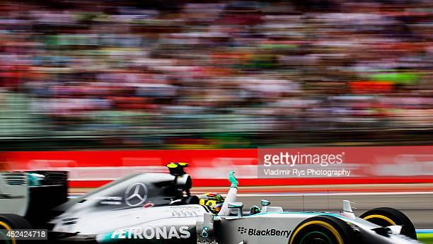 Nico Rosberg of Germany and Mercedes GP Petronas celebrates after winning the German Formula One Grand Prix at Hockenheimring on July 20, 2014 in...