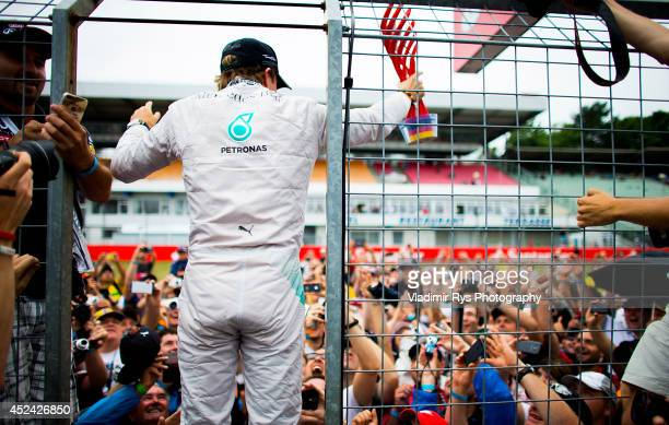 Nico Rosberg of Germany and Mercedes GP Petronas celebrates with his fans after winning the German Formula One Grand Prix at Hockenheimring on July...
