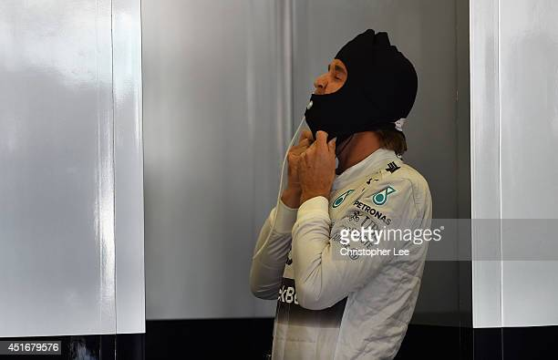 Nico Rosberg of Germany and Mercedes GP prepares in the team garage during practice ahead of the British Formula One Grand Prix at Silverstone...