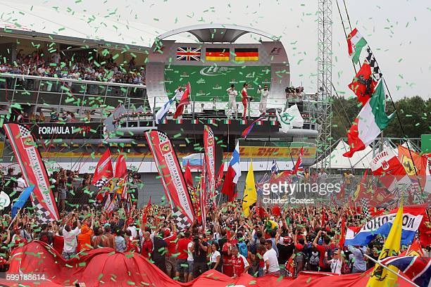 Nico Rosberg of Germany and Mercedes GP Sebastian Vettel of Germany and Ferrari and Lewis Hamilton of Great Britain and Mercedes GP celebrate on the...