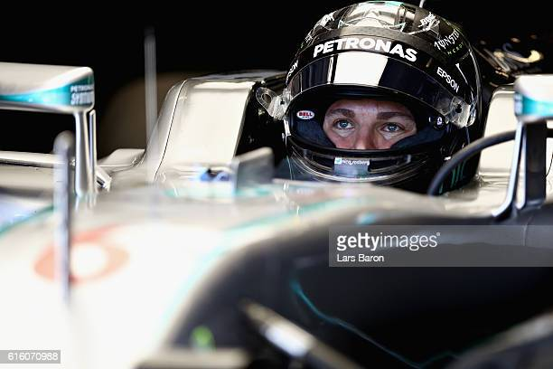 Nico Rosberg of Germany and Mercedes GP sits in his car in the garage during practice for the United States Formula One Grand Prix at Circuit of The...