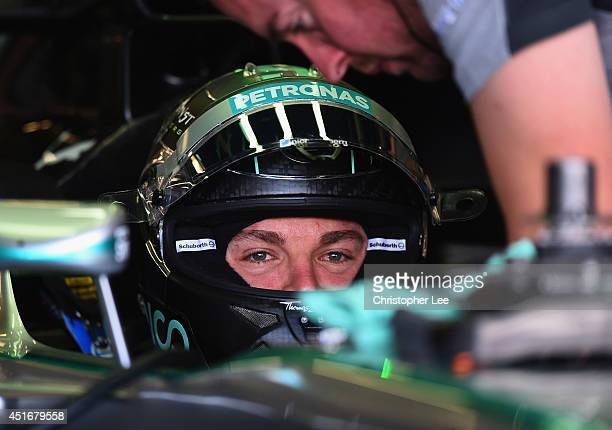 Nico Rosberg of Germany and Mercedes GP sits in his car in the team garage during practice ahead of the British Formula One Grand Prix at Silverstone...