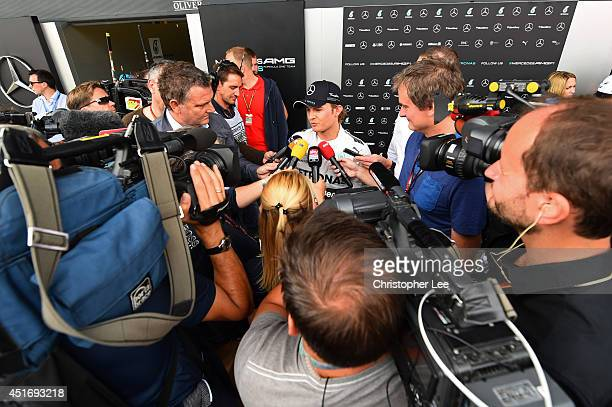 Nico Rosberg of Germany and Mercedes GP speaks with members of the media after practice ahead of the British Formula One Grand Prix at Silverstone...