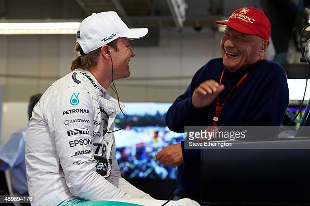 Nico Rosberg of Germany and Mercedes GP speaks with Mercedes GP nonexecutive chairman Niki Lauda in the garage during practice for the Formula One...