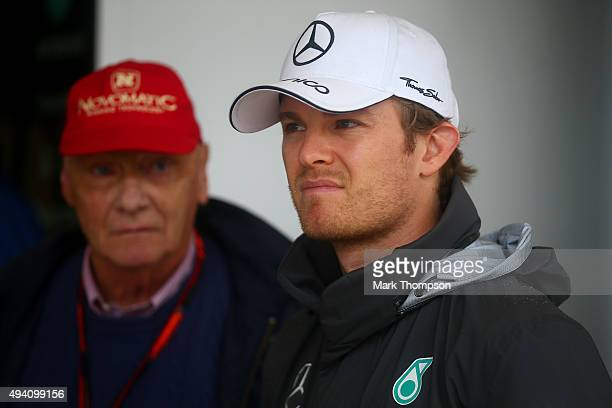 Nico Rosberg of Germany and Mercedes GP speaks with Mercedes GP nonexecutive chairman Niki Lauda in the pit lane after qualifying was suspended due...