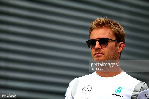 Nico Rosberg of Germany and Mercedes GP walks in the Paddock before practice for the Formula One Grand Prix of Austria at Red Bull Ring on July 1...