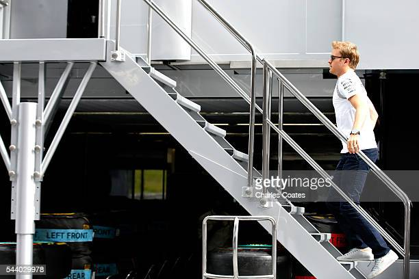 Nico Rosberg of Germany and Mercedes GP walks into a Mercedes truck in the Paddock before practice for the Formula One Grand Prix of Austria at Red...
