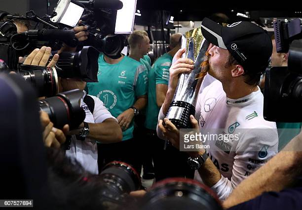 Nico Rosberg of Germany and Mercedes GP with his trophy after winning the Formula One Grand Prix of Singapore at Marina Bay Street Circuit on...