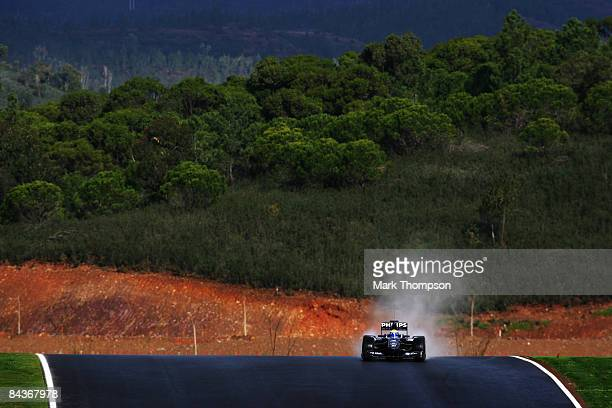 Nico Rosberg of Germany and Williams drives the new Williams FW31 during Formula One winter testing at the Autodromo Internacional do Algarve on...