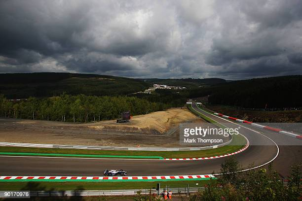 Nico Rosberg of Germany and Williams drives under the sullen skies of the Ardennes Forest during the final practice session prior to qualifying for...
