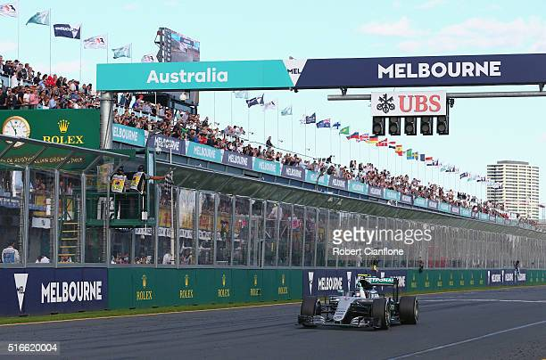 Nico Rosberg of Germany drives the Mercedes AMG Petronas F1 Team Mercedes F1 WO7 Mercedes PU106C Hybrid turbo on track takes the chequered flag...
