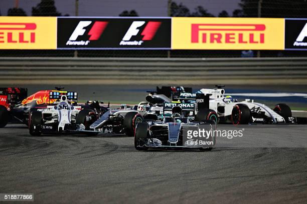 Nico Rosberg of Germany drives the Mercedes AMG Petronas F1 Team Mercedes F1 WO7 Mercedes PU106C Hybrid turbo leads the field as Lewis Hamilton of...