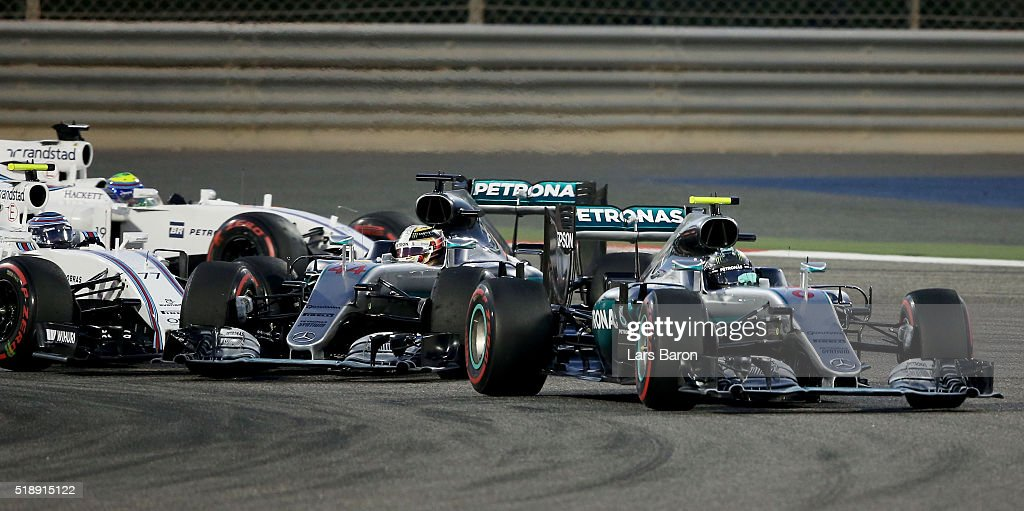 Nico Rosberg of Germany drives the (6) Mercedes AMG Petronas F1 Team Mercedes F1 WO7 Mercedes PU106C Hybrid turbo on track ahead of Lewis Hamilton of Great Britain drives the (44) Mercedes AMG Petronas F1 Team Mercedes F1 WO7 Mercedes PU106C Hybrid turbo as he gets hit by Valtteri Bottas of Finland drives the (77) Williams Martini Racing Williams FW38 Mercedes PU106C Hybrid turbo during the Bahrain Formula One Grand Prix at Bahrain International Circuit on April 3, 2016 in Sakhir, Bahrain.